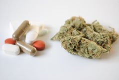 Pills and Marijuana royalty free stock images