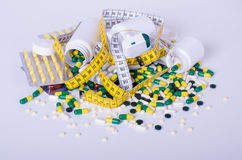 Pills and measuring tape isolated, concept diet Stock Images