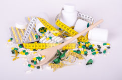 Pills and measuring tape , wood spoone, concept diet Stock Photo