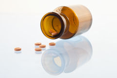 Pills and medical flask Stock Photos