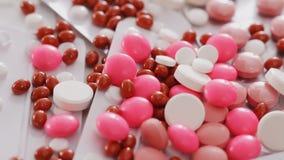 Pills and medications closeup rotating stock video footage