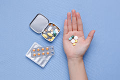 Pills and medicine capsule in hand Stock Images