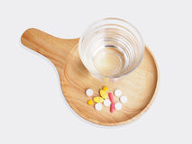 Pills medicine and glass of water Royalty Free Stock Photo