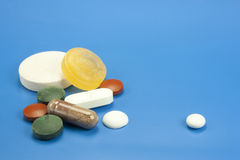 Pills and medicines. Medicines and pills in different shapes and colors Royalty Free Stock Photo