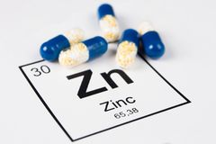 Blue pills with mineral Zn Zincum on a white background with a Stock Photos