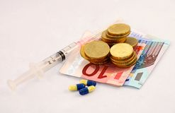 Pills and money Royalty Free Stock Photo