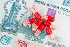 Pills and money Stock Photos