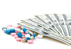 Pills and money Stock Images