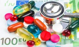 Pills and money Stock Photo