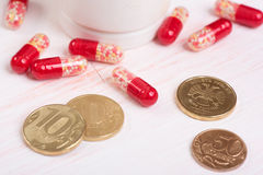 Pills and money. Health care concept Royalty Free Stock Photos
