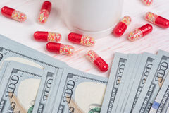 Pills and money. Health care concept Royalty Free Stock Image