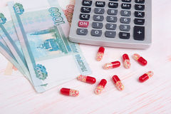 Pills and money. Health care concept Stock Image