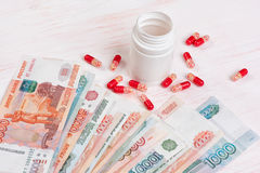 Pills and money. Health care concept Stock Photo