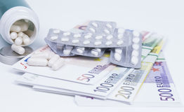 Pills and money Royalty Free Stock Photography