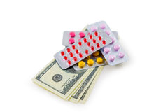 Pills and money. Are photographed on the white Royalty Free Stock Photography