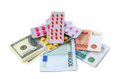 Pills and money. Are photographed on the white Stock Image