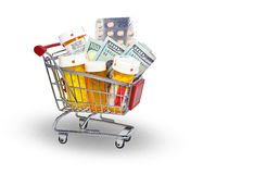 Pills and money in shopping cart stock photo