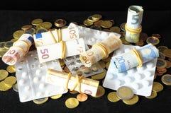 Pills And Money Stock Photos
