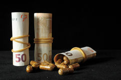 Pills And Money. Some Pills And Money on a Black Background stock photography