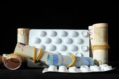 Pills And Money. Some Pills And Money on a Black Background royalty free stock photos