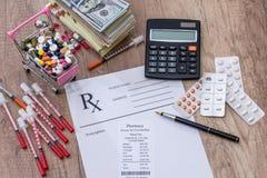 Pills, money  syringe  insulin. rx. On desk Royalty Free Stock Image