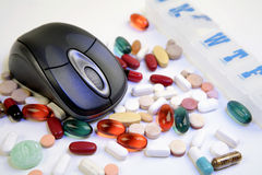Pills & mouse Royalty Free Stock Photography