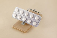 Pills on Mousetrap Royalty Free Stock Image