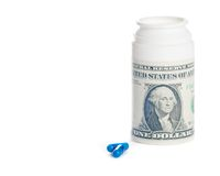 Pills near dollar on pills container, cost of medical health care Stock Photography