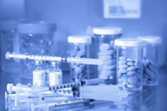 Pills and needles/Blue tone Stock Photos