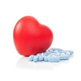 Pills next to red heart - studio shot Stock Photos