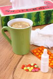 Pills and nose drops for colds, handkerchiefs and hot tea with lemon Royalty Free Stock Photos