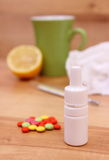 Pills and nose drops for colds, used handkerchiefs and hot tea with lemon Royalty Free Stock Image