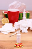 Pills and nose drops for colds, used handkerchiefs and hot tea with lemon Royalty Free Stock Images