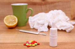 Pills and nose drops for colds, used handkerchiefs and hot tea with lemon Stock Image