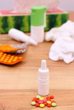 Pills and nose drops for colds, used handkerchiefs and other medication Stock Photography