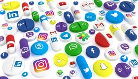 Pills Of Various Types And Sizes Bearing The Logo Of The Most Famous Social Networks Royalty Free Stock Photo