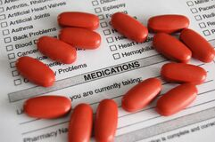 Pills On Top Of A Medications Form Stock Image