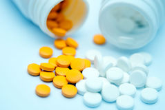 Pills and opening medicine bottle Royalty Free Stock Photos