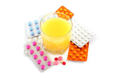 Pills and orange soda. Medical pills and orange soda or juice Royalty Free Stock Image