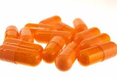 Pills. Orange pills on a white background stock photo