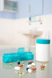Pills and organiser. In bathroom Stock Images