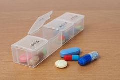 Pills organizer on a table Royalty Free Stock Photo