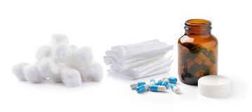 Pills out of bottle and Cotton wool bandage. On white background Royalty Free Stock Photos