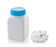 Pills out of bottle on white background Stock Photos