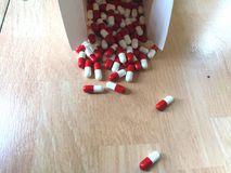 Pills out of the box stock photos