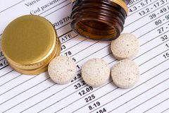 Pills out of container Royalty Free Stock Images
