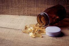 Pills out of a pill bottle Royalty Free Stock Photo