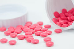 Pills outside the container bottle Royalty Free Stock Photography