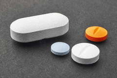 Pills over a black background. Medicament treatment. Health care Royalty Free Stock Image