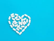 Pills over blue background Stock Photo